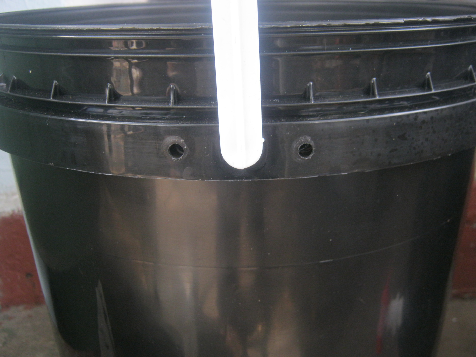 Working bin of a worm farm with 2 ventilation holes near the top of its side